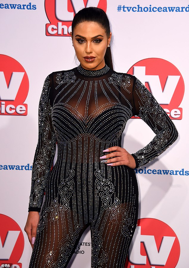 Racy display:Anna teased a hint of her racy black underwear underneath the skintight catsuit, which was adorned with an intricate beaded pattern