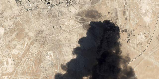 Thick black smoke rising from Saudi Aramco's Abqaiq oil processing facility in Buqyaq, Saudi Arabia, on Saturday, captured in a satellite image. (Planet Labs Inc via AP)