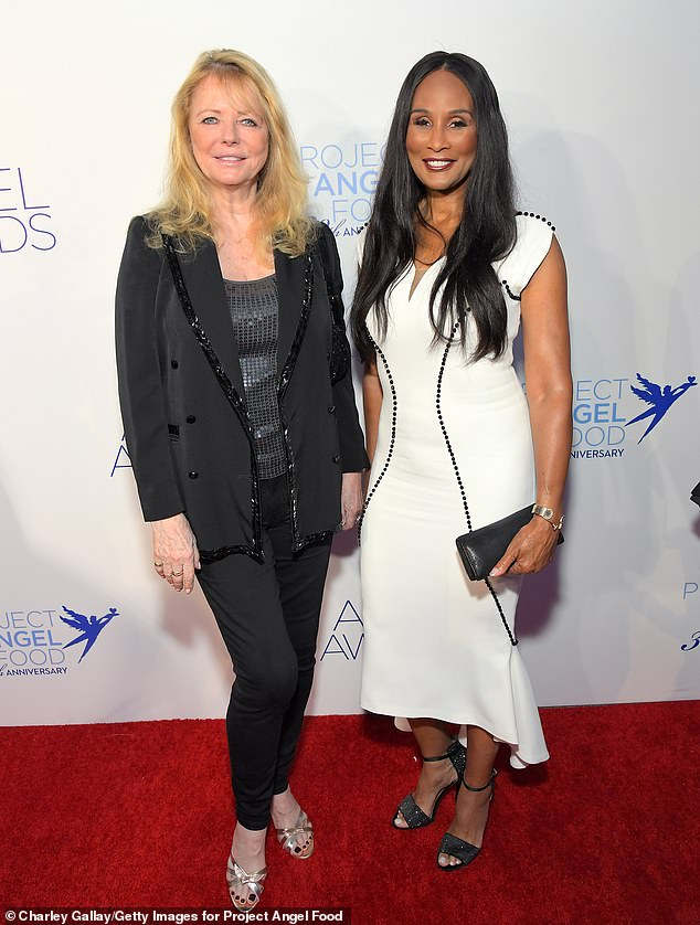 Yassss! Eighties supermodels Cheryl Tiegs (L), 71; and Beverly Johnson (R), 66; reunited on the red carpet in black and white attire, respectively