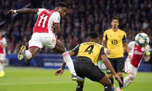 Quincy Promes heads Ajax into the lead.