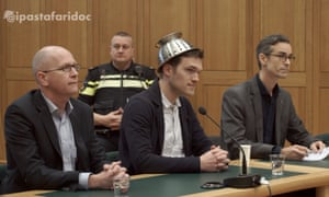Mathé Coolen, an archbishop of Pastafarianism, wearing his colander in court
