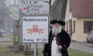 Bruder Spaghettus, a church minister, by a 'noodle mass' sign