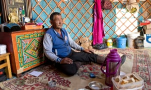 Mongolian nomad inside his ger home.