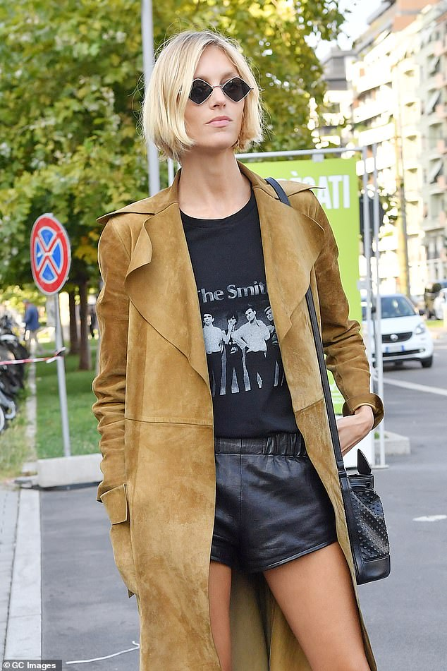 Glamming it up:Anja Rubik donned a chic suede jacket with leather shorts