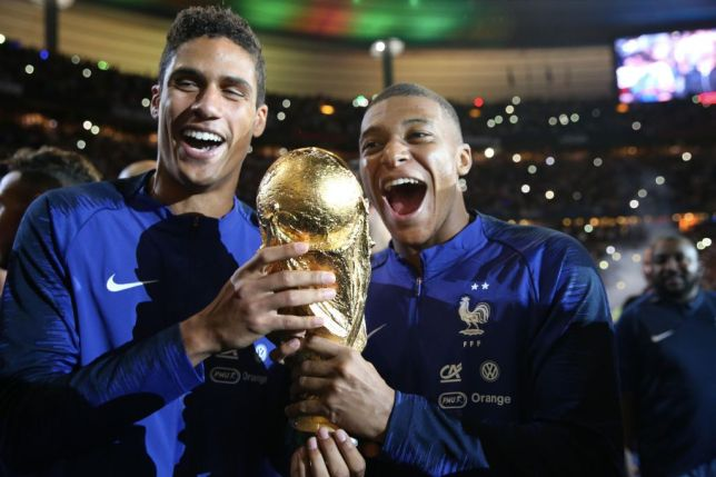 Raphael Varane and Kylian Mbappe celebrate winning the World Cup