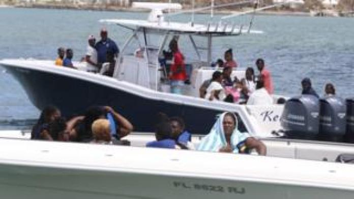 Hurricane Dorian survivors board private boats to be evacuated from Great Abaco Island
