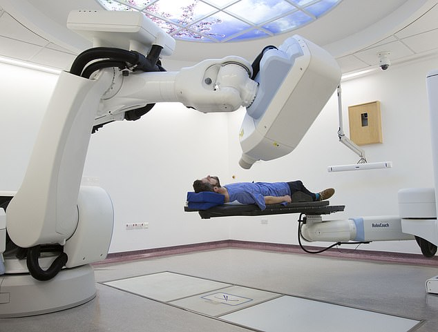 A patient taking part in the trial is treated with radiotherapy using the CyberKnife machine