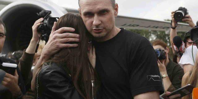 Ukrainian filmmaker Oleg Sentsov hugs his daughter upon his arrival at Boryspil airport, outside Kyiv, Ukraine, Saturday, Sept. 7, 2019.