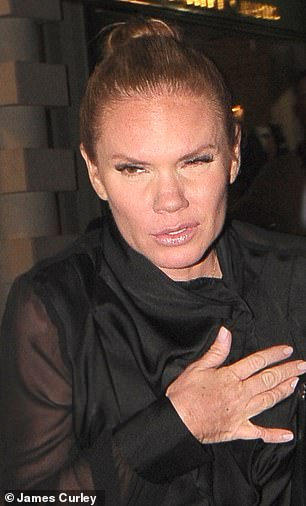 Fun night? Victoria Beckham's lookalike sister Louise Adams appeared worse for wear after attending the Wellington club at restaurant launch in London on Thursday