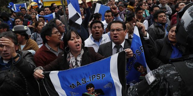 Supporters of Bolivian President Evo Morales, who is running for a fourth term, rally outside the Supreme Electoral Court where election ballots are being counted in La Paz, Bolivia, Monday, Oct. 21, 2019.