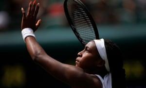 Cori Gauff prepares to smash a high ball during her match with Simona Halep at Wimbledon.