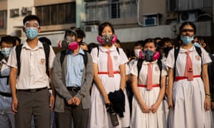 Students stand outside the Tsuen Wan Public Ho Chuen Yiu Memorial College during a demonstration held to show solidarity with the injured student in Hong Kong