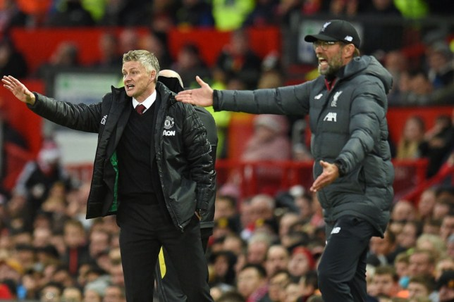 Manchester United's Norwegian manager Ole Gunnar Solskjaer (L) and Liverpool's German manager Jurgen Klopp (R) gesture on the touchline during the English Premier League football match between Manchester United and Liverpool at Old Trafford in Manchester, north west England, on October 20, 2019. (Photo by Oli SCARFF / AFP) / RESTRICTED TO EDITORIAL USE. No use with unauthorized audio, video, data, fixture lists, club/league logos or 'live' services. Online in-match use limited to 120 images. An additional 40 images may be used in extra time. No video emulation. Social media in-match use limited to 120 images. An additional 40 images may be used in extra time. No use in betting publications, games or single club/league/player publications. / (Photo by OLI SCARFF/AFP via Getty Images)