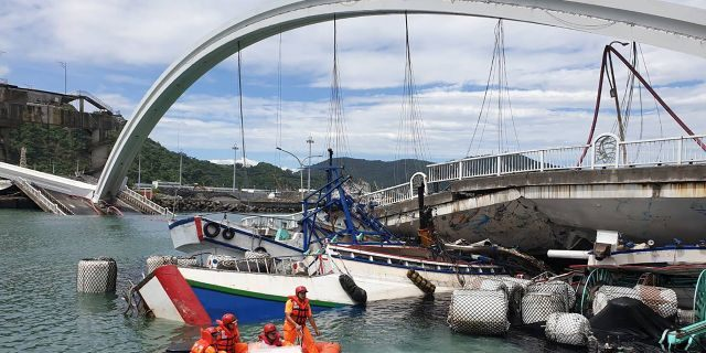 Rescuers work near the site of a collapsed bridge in Nanfangao, eastern Taiwan. Tuesday, Oct. 1, 2019. (Taiwan's Coast Guard via AP)