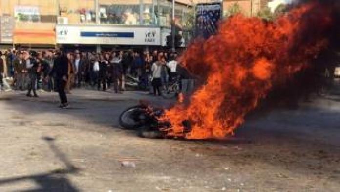 Iranian protesters in the streets following fuel price increase in the city of Isfahan, central Iran, 16 November 2019