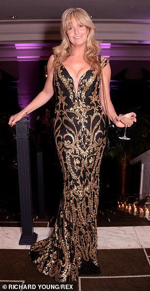 Stunning: Penny Lancaster, 48, put on a busty display in a plunging black and gold sequinned dress for a Memories That Matter event