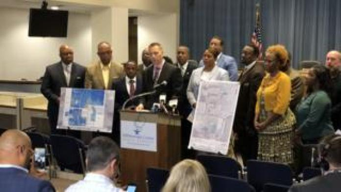 Superintendent Jeff Eakins speaks at a podium about the findings