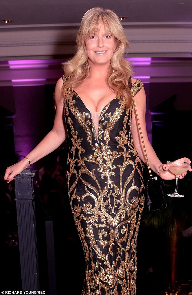A star: With her phenomenal dress, Penny added a black velvet shoulder bag which featured a gold chain