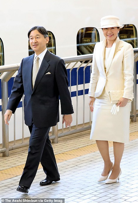 The pair are seen boarding a train tothe Ise Shrine from Tokyo, Japan