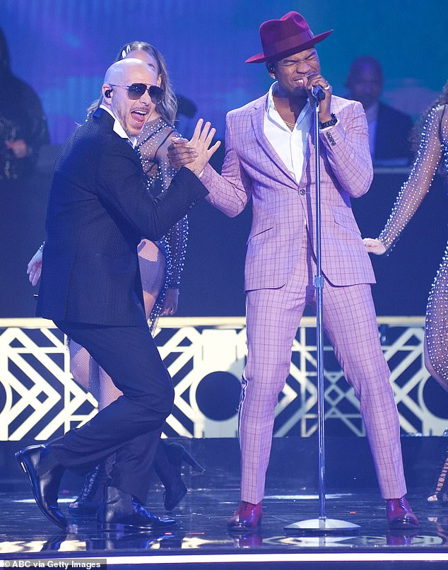 Teaming up: Singers Pitbull and Ne-Yo also hit the stage to perform Me Quedaré Contigo and 3 To Tango, joined by the entire 2019 DWTS cast