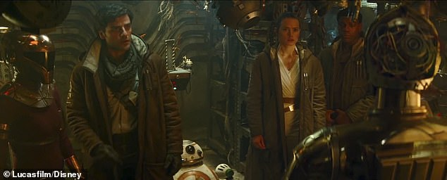 His pals: He is saying goodbye to Rey, Finn (John Boyega) and Poe Dameron (Oscar Issac) as well as Zorii Bliss, far left