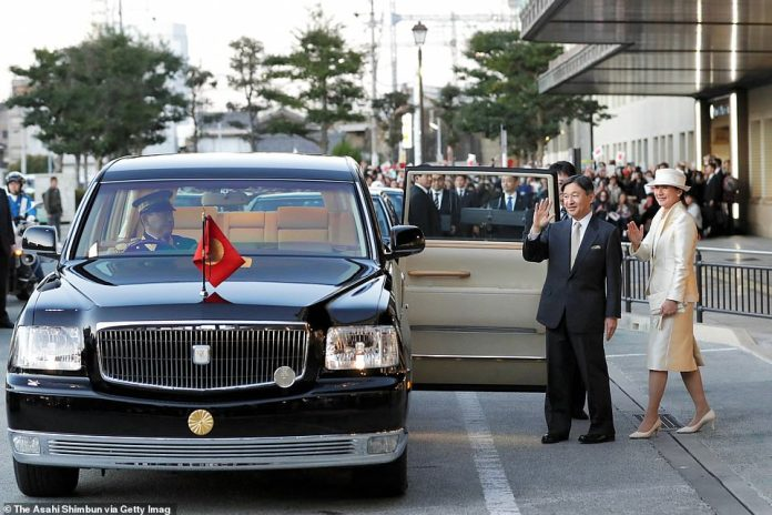 Emperor Naruhito and Empress Masako wave to well-wishers on arrival at the Uji Yamada Station on their way to the Ise Shrine yesterday