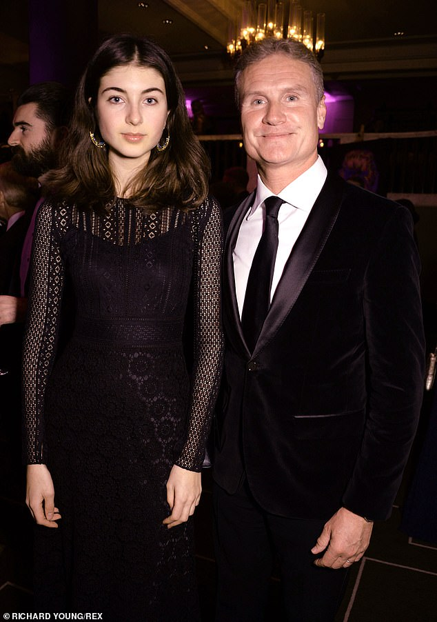 Happy: Karen Minier [L] and David Coulthard also happily posed together inside the charity event