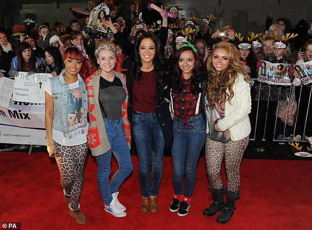 Here come the girls! Tulisa mentored Little Mix during their stratospheric rise to fame in 2011 (pictured following their win)