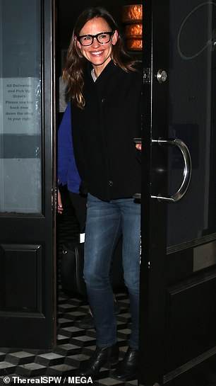 Casual:Jennifer cut a casual figure in a pair of blue skinny jeans with a cropped black jacket and thick framed square glasses