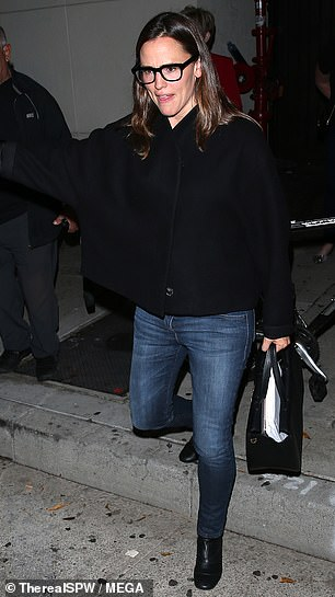 Details: ThePearl Harbor star finished her look with a pair of black heeled ankle boots and a matching coloured handbag