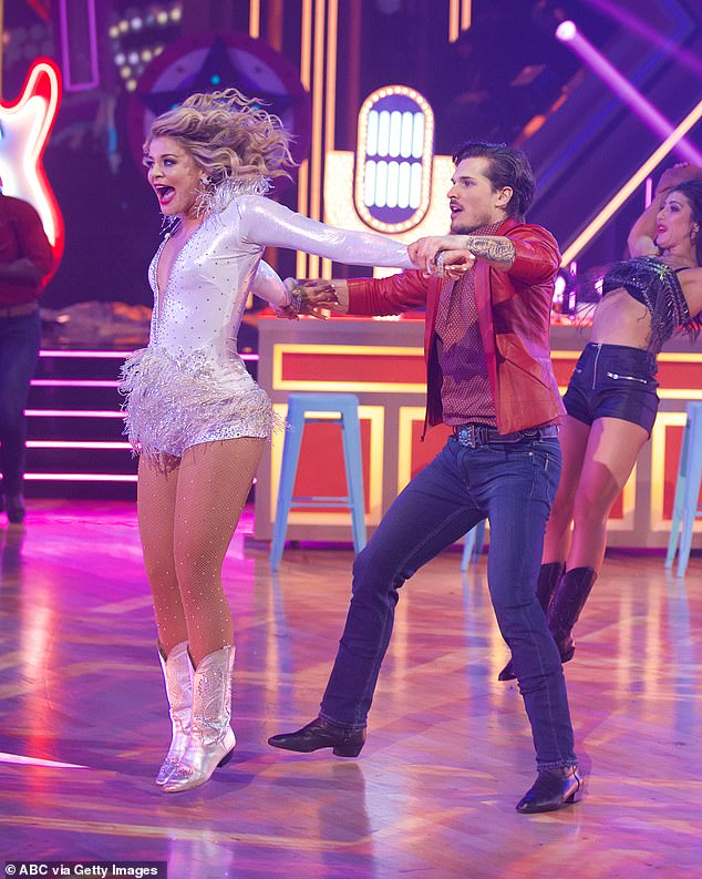 Fun routine: Lauren's freestyle included line dancing, cartwheels, in-air spinning, and the singer belting on the microphone