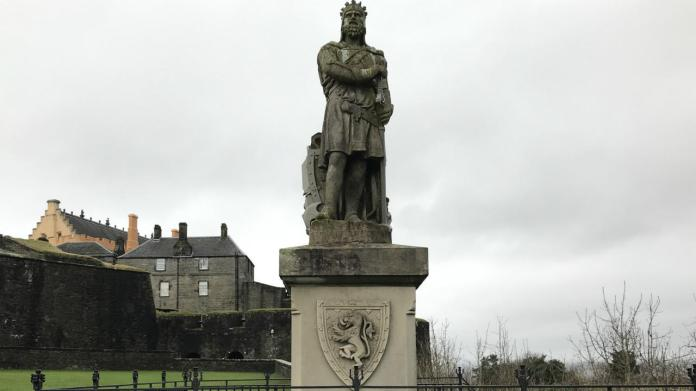 The statue of Robert the Bruce looks out over Stirling from the grounds of its medieval castle.