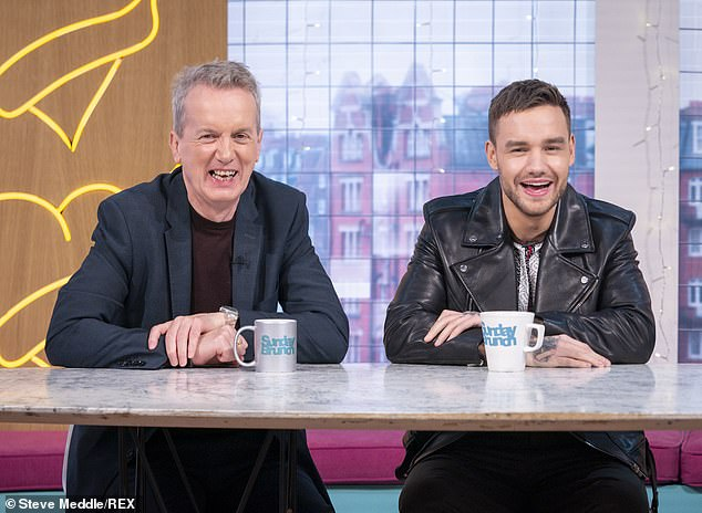 Happy: Liam appeared in high spirits as he chatted away to Frank Skinner