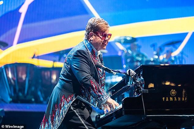 Alive:Elton put on an animated display as he riled up the crowd, standing up from his piano