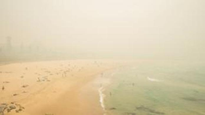 Bondi Beach obscured by a thick layer of smoke