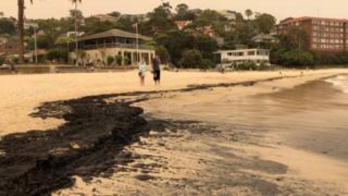 Black ash covers Sydney's Balmoral Beach
