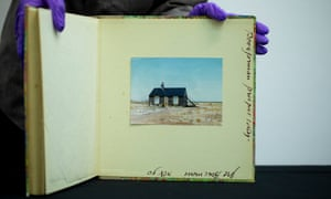 A photograph of Prospect Cottage in a notebook belonging to Derek Jarman, one of the objects that have been given to Tate.