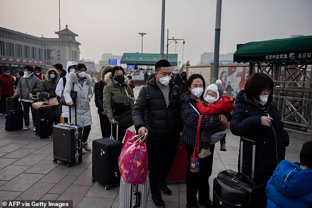 The intensifying health crisis has led the authorities to quarantine at least 56 million people living in central China's Hubei Province. In the picture above, people wearing face masks to avoid the disease queue to take a taxi at the Beijing railway station on January 27
