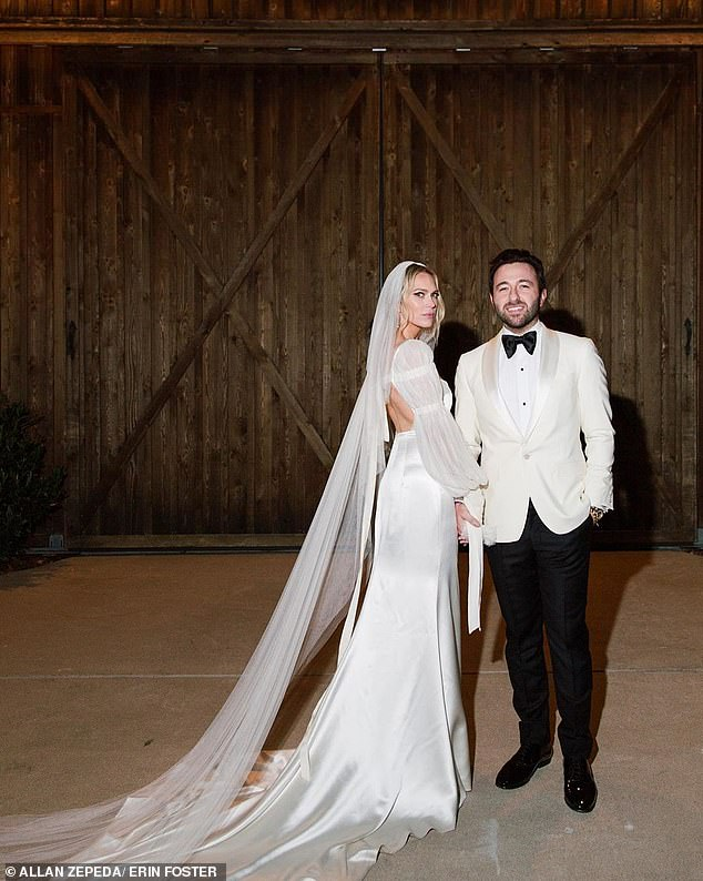 Mr. and Mrs.: Erin looked incredible in an exquisite Danielle Frankel wedding gown