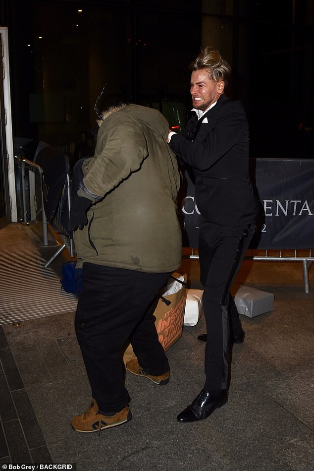 Chris was seen exiting the venue, separately from Jesy, lugging several bags with him