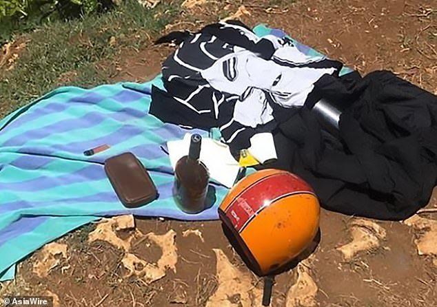 An abandoned motorbike was seen parked near the scene and closer to the cliff edge a bag filled with a helmet, a bottle of spirit and a letter to his former lover