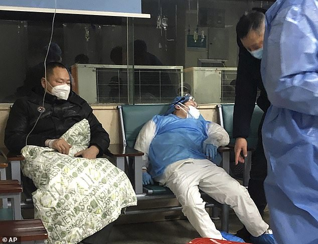 The coronavirus epidemic has killed at least 131 people - all in China - and sickened nearly 6,000 worldwide as of today. In the picture above,a medical worker (right) rests in a chair next to a patient at a hospital in Wuhan in central China's Hubei Province on January 23