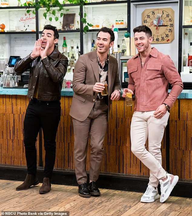 All together: The trio appeared on Seth Meyer's late night talk show in the sketch 'Day Drinking with the Jonas Brothers' on January 21st in New York