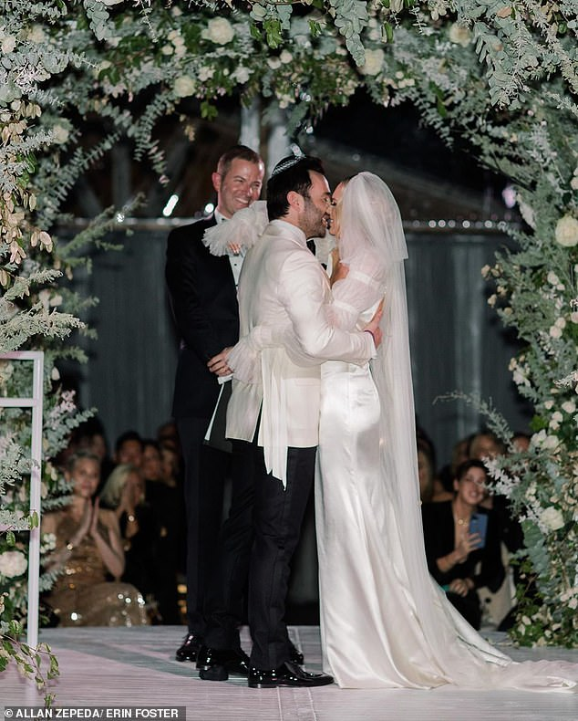 Kiss her! The couple shared their first kiss as husband and wife