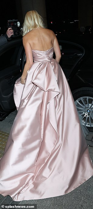 She was spotted bundling her large pink princess tulle skirt into a taxi as she made her way to a private NTAs after party