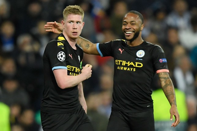 Manchester City's Belgian midfielder Kevin De Bruyne (L) celebrates with Manchester City's English midfielder Raheem Sterling after scoring a goal during the UEFA Champions League round of 16 first-leg football match between Real Madrid CF and Manchester City at the Santiago Bernabeu stadium in Madrid on February 26, 2020.