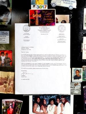 A letter hangs on Alfonzo Tucker's refrigerator stating that his right to vote has been revoked in Tuscaloosa County.