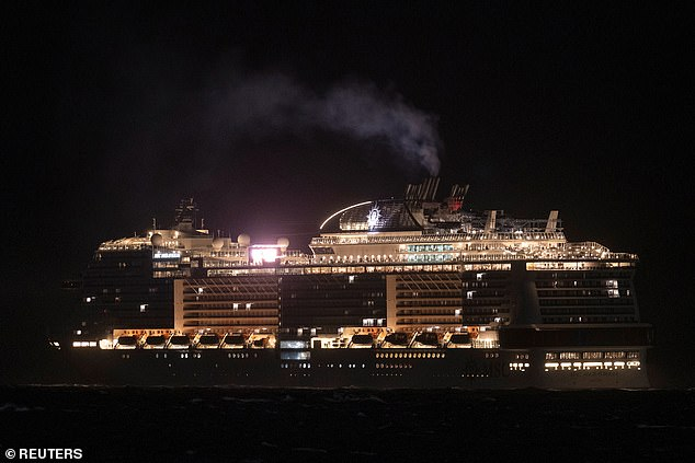 Cruise ship MSC Meraviglia is currently waiting off the coast of Cozumel, Meixco (pictured), where it is due to dock Thursday before health inspectors will decide whether passengers can come ashore