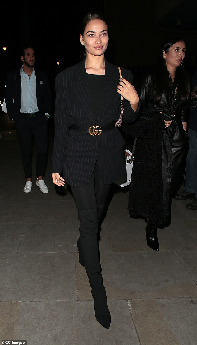 Victoria's Secret model Shanina Shaik, 29, (pictured) oozed glam in a striped blazer and Gucci belt as she attended a private dinner during London Fashion Week on Tuesday