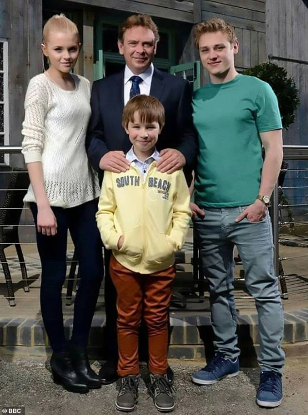Not so tall: The previous incarnation of the character, played by Ben Hardy, was a mere 5ft 8 inches tall (pictured with the Beale family)